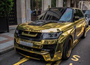 gold range rover - rost cen